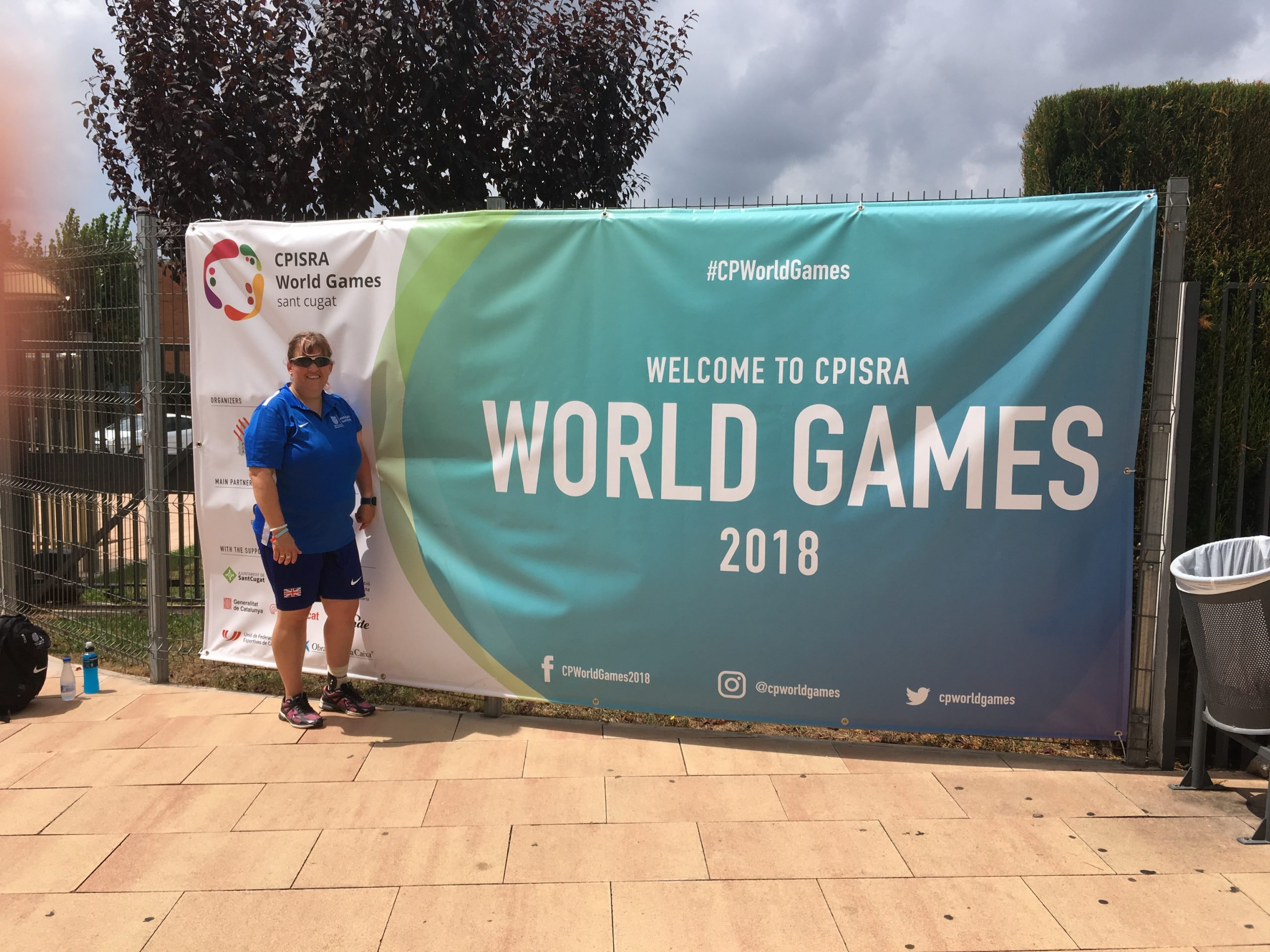 Claire stood infront of a the CPISRA world Games banner